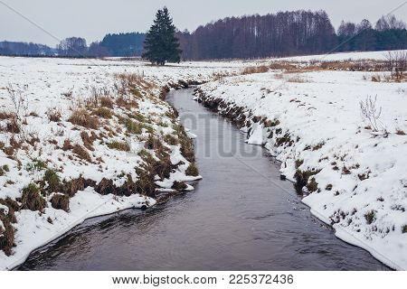 Winter Scenery Near Soce Village, Podlasie Region Of Poland. View With Small Rudnia River