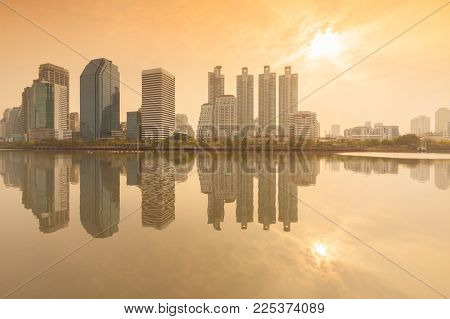 Business District Cityscape From A Park With Sunrise Time From Benchakitti Park, Bangkok Thailand