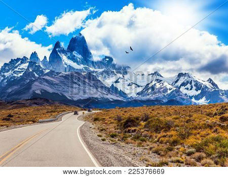 Fine highway to the majestic Mount Fitz Roy. Argentine Patagonia. Summer day in February. The concept of active and extreme tourism. The Andean condors hover over the prairie