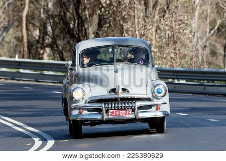 Adelaide, Australia - September 25, 2016: Vintage 1953 FJ Holden Utility (Ute) driving on country roads near the town of Birdwood, South Australia.