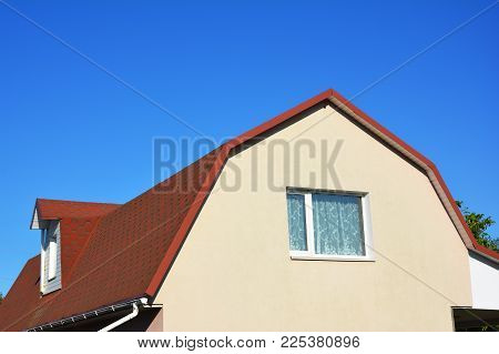 House Attic Dormer Window And Roofing Construction. Gable Roof And Dormer Type Of Roof Outdoors.