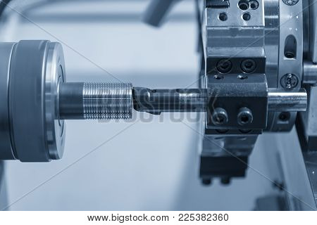 The CNC lathe machine cutting the thread at the end of the pipe.The water pipe manufacturing process.