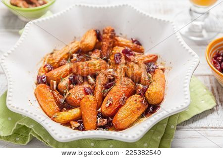 Honey Glazed Baby Carrots With Cranberry, Thyme and Pecan Nuts