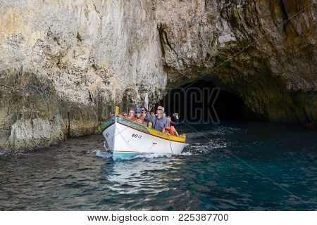 Blue Grotto, Malta - 3 November 2017: Tourists Visiting The Coast By Boat At Blue Grotto In The Malt