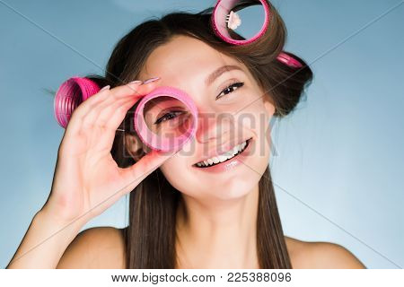 Happy Woman With Big Curlers On Head On Blue Background