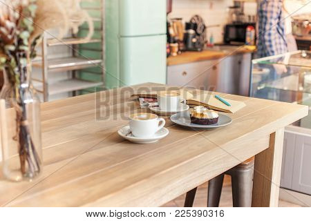 A Table Setting On The Counter At A Coffee House. Barista, Cafe, Making Coffee, Preparation And Serv
