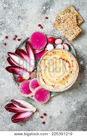 Homemade Hummus Seasoned With Olive Oil And Paprika And Fresh Vegetables: Radishes, Watermelon Radis