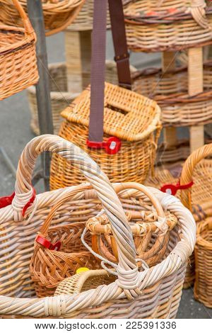 Close Up On Full Of Wicker Baskets Handmade Under Sunny Day