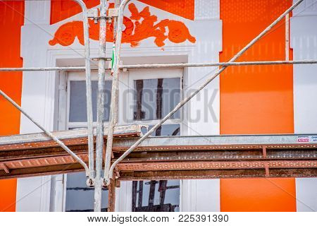Painter's Scaffold With Orange House In The Background