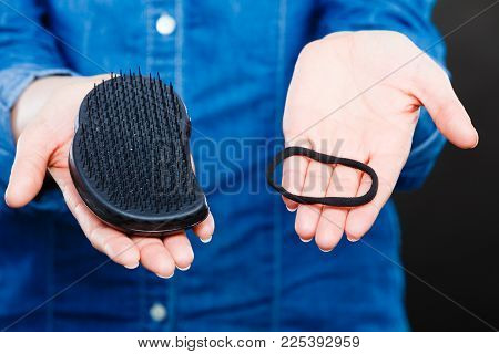 Everyday Morning Routine. Female Hands With Black Comb Hairbrush And Elastic Hair. Woman With Barber