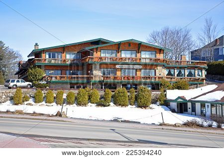 LAKE PLACID, NY, USA - MAR. 20, 2011: Best Western Adirondack Inn in Lake Placid Olympic Center, Lake Placid, New York State, USA. Lake Placid hosted 1932 and 1980 Winter Olympic Games, Adirondack Mountains, New York, USA.