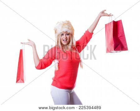 Clothing Accessories, Buying Seasonal Clothes Concept. Woman Wearing Red Jumper And Winter Furry War