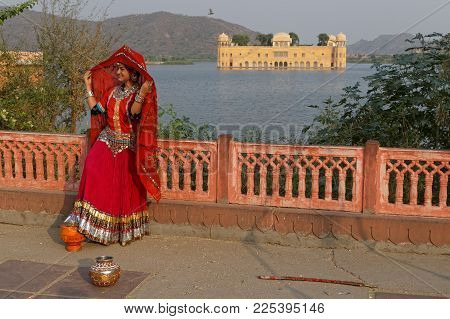 JAIPUR, INDIA, October 26, 2017 : Indian people like to have photographs at Water palace. Jaipur is a popular tourist destination in India. and serves as a gateway to other tourist destinations in Rajasthan