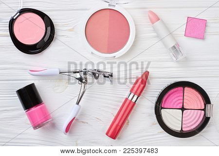 Set Of Decorative Cosmetics, Wooden Background. Eyelashes Curler And Pencil Lipstick. Make Up Artist