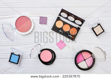 Set Of Eyeshadows, Top View. Collection Of Blushers And Eyeshadows On Wooden Background. Decorative