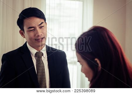 Business Man Looking Interested While Dealing With Partner