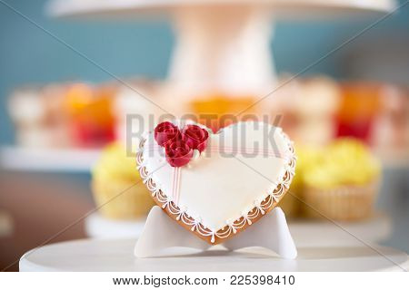 Sweet Gingerbread Cookie, Covered With White Delicious Glaze And Decorated With Red Glaze Roses And