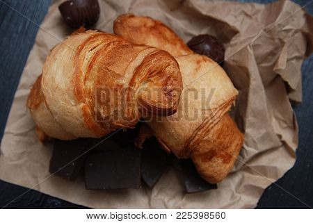 Close Up Of Croissant Or Rolls Over Brown Craft Paper