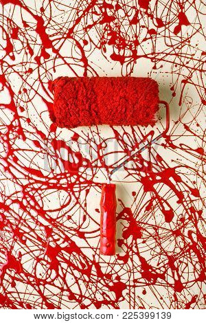 Roller paint brush with red paint around