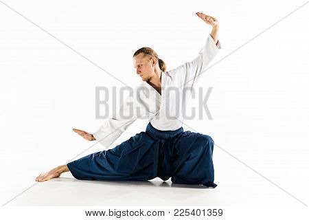 Aikido Master Practices Defense Posture. Healthy Lifestyle And Sports Concept. Man With Beard In Whi