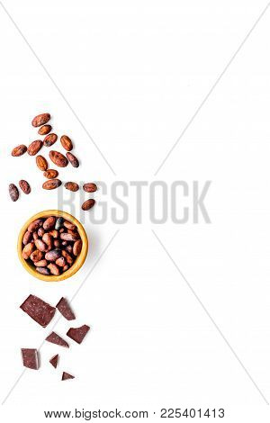 Roasted Cocoa Beans On White Background Top View Copy Space. Raw Material For Cocoa Powder. African