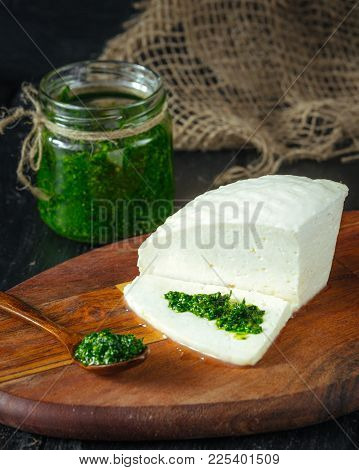 Traditional Caucasian Homemade Cheese On Wooden Board, With Pesto, Selective Focus