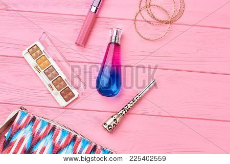 Female Pouch And Cosmetics, Colorful Background. Woman Cosmetics With Cosmetic Bag On Pink Wooden Ba