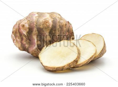 One Jerusalem Artichoke Tuber With Three Round Slices Isolated On White Background Sweet Crisp Topin
