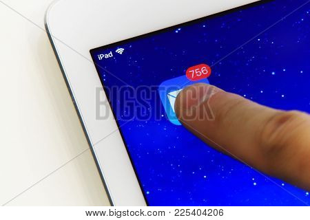 New York, Usa - February 02, 2018: Finger Touching Mail Application Icon On Ipad Screen With Many Ne