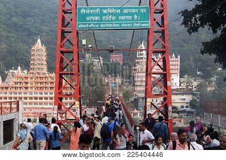 Rishikesh, India - November, 2nd, 2017. Lakshman Jhula Bridge And Tera Manzil Temple, Trayambakeshwa