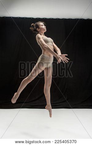 Young Teen Dancer Dancing On White Floor Studio Background. Ballerina Project.