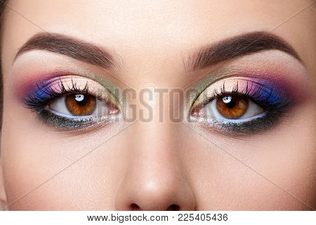 Closeup View Of Brown Female Eyes With Evening Makeup. Colorful Pink And Blue Smokey Eyes. Studio Sh