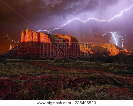 An Hdr Composition Of A Lightning Storm Approaching Courthouse Butte Near Sedona Arizona. Composed F