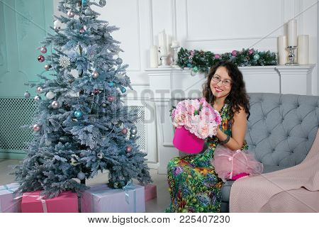 Happy Surprised Asian Woman Holding Gift Box With Beautiful Flowers At Home. Christmas Consept