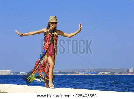 On The Pier One Girl Running. Entertainment, Recreation, Entertainment, Entertainment. Background Of
