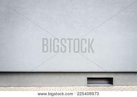 Modern Light Blue Plaster Wall With Small Basement Window