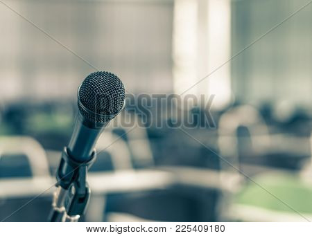 Microphone Speaker In School Lecture Hall, Seminar Meeting Room Or Educational Business Conference E