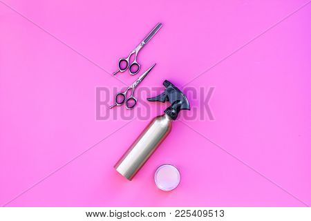 Professional Hairdressing Tools In Beauty Saloon. Spray, Sciccors On Pinl Background Top View.