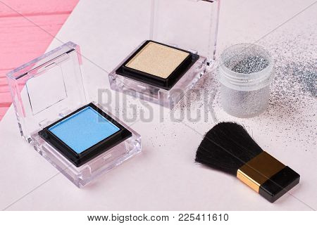 Fashion Beauty Essentials For Make Up. Colorful Eyeshadows And Brush For Make Up. Make Up Silver Gli