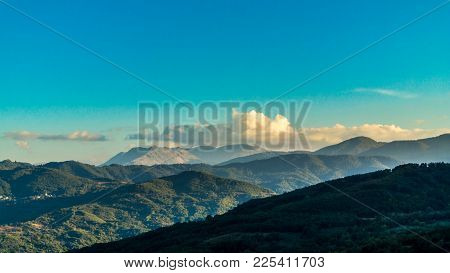 A Landscape Capture Showing The Clouds Starting To Disappear Behind The Mountains