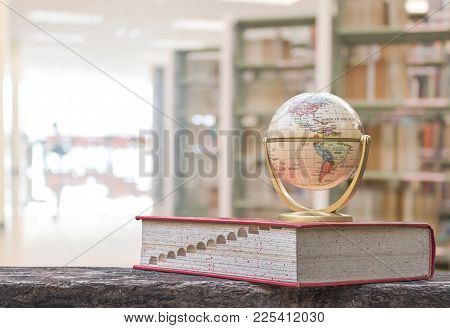 February 7, 2018 - Bangkok, Thailand: Globe Model On Textbook, Or Dictionary On  Table In School Or