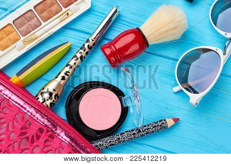 Female Cosmetics Essentials On Wooden Background. Close Up Woman Makeup Products And Tools. Feminine