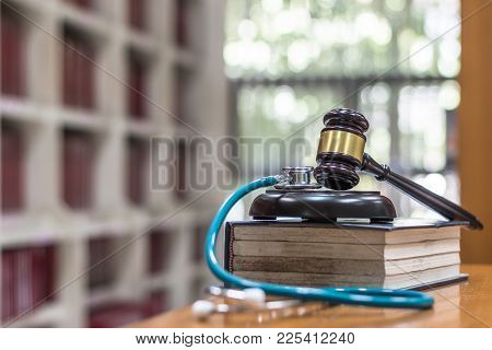 Forensic Medicine Investigation Or Malpractice Justice Concept With Judge Gavel And Medical Stethosc