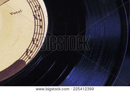 Border Of Musical Staff And Notes On An Old 45 Rpm Record