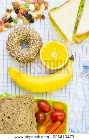 Lunch Items Set With Vegetables In Green Lunch Box, Fresh Fruit, Candy Fruit, Sandwiches And Chocola
