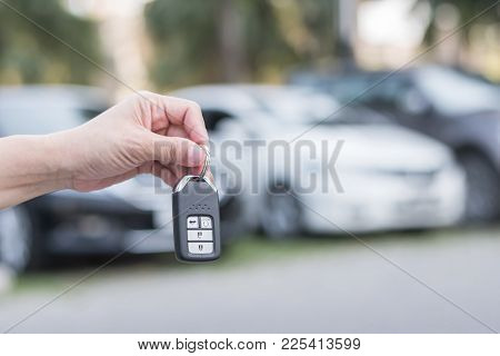 Car Valet Parking Service Business Concept With People Handling Car Key On Blur Parking Lot Backgrou