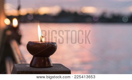 Spirituality And Tranquility Abstract Concept With Candle Light Illumination And Golden Sunset Sky