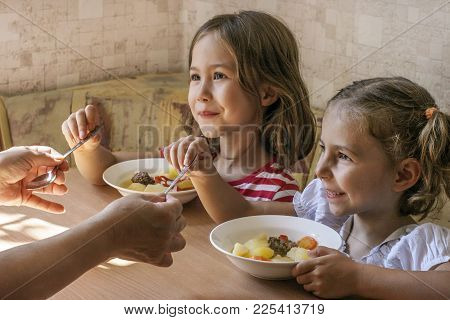 Grand Daughters Have Dinner With Their Grandmother