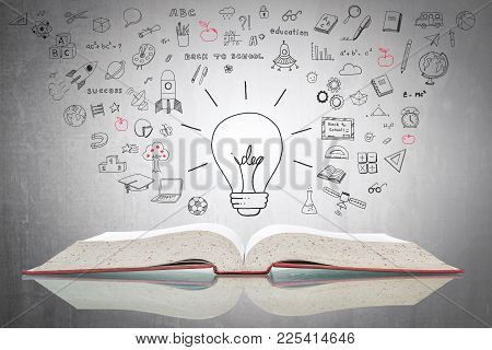 World Intellectual Property Day And Education Concept With Innovative Light Bulb On Book With Doodle