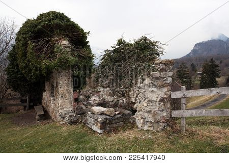 Two Old Stone Walls.  A Big One With 2 Window Holes, The Other Small One. Both Are Partially Disinte